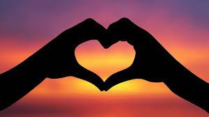 heart hands sunset background