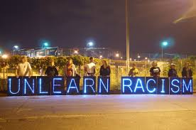 unlearn racism in lights dark street