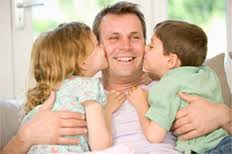 happy dad with kids kissing him