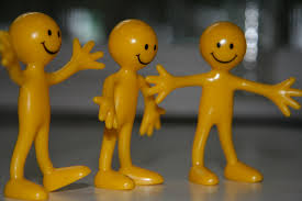three happy yellow figures standing.jpg