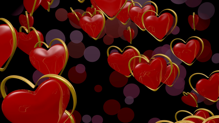 red-hearts-with-revolving-gold-outlines-falling-on-a-dark-background-with-transparent-circles_4xo7a2q9x__F0000.png